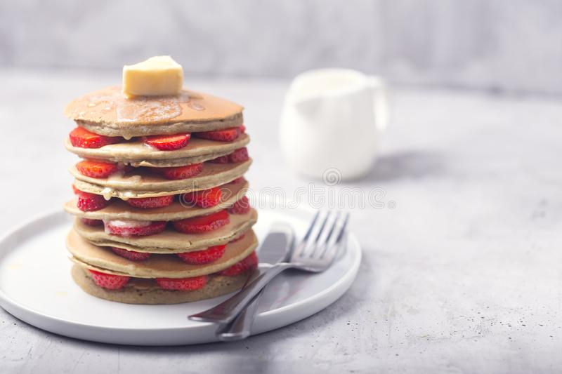 Sweet Homemade Pancakes with strawberries and Butter. Ready for breakfast royalty free stock image