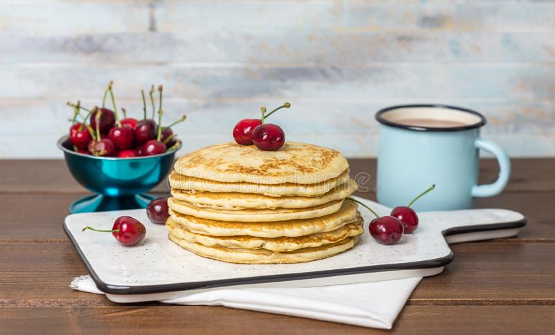 Sweet Homemade Stack of Pancakes with cherries stock photography
