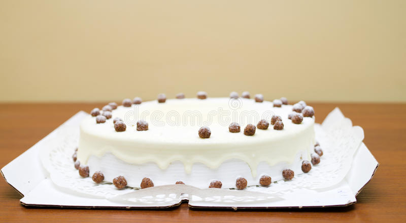 Sweet honey cake with cream and nuts stock image
