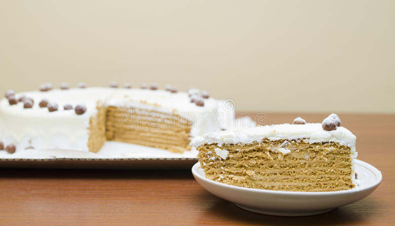 Sweet honey cake with cream and nuts stock images
