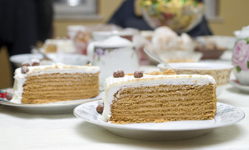 Sweet honey cake with cream and nuts royalty free stock photos