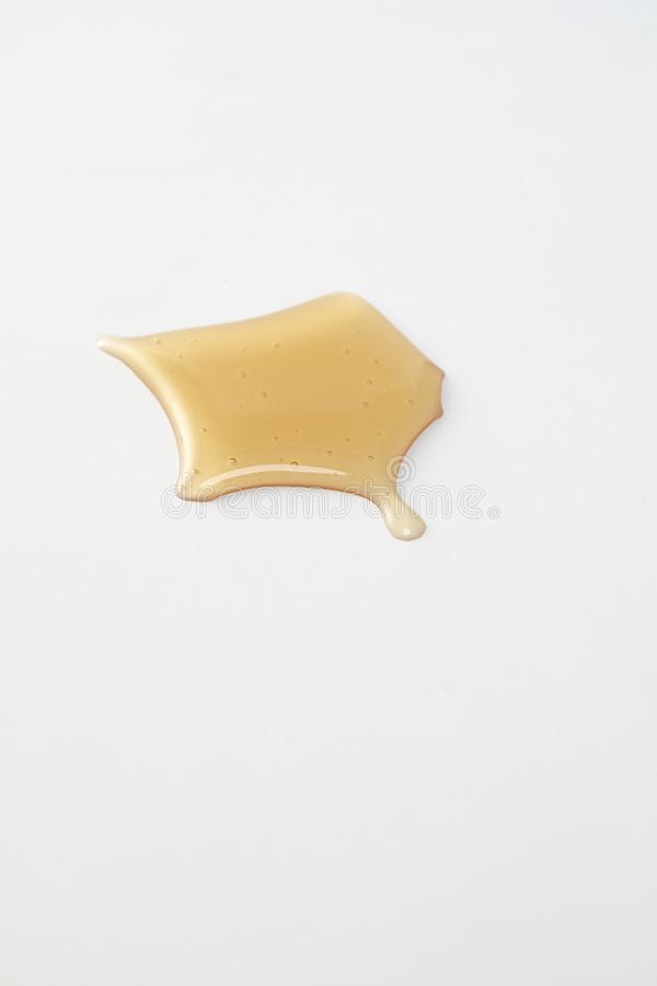 Sweet honey drips on white royalty free stock photography