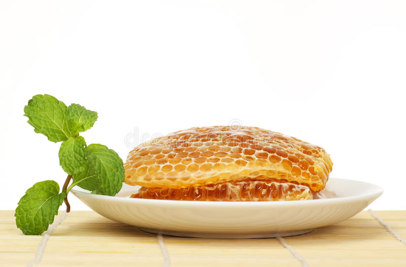 Sweet honeycombs in dish with lemon and mint stock photography