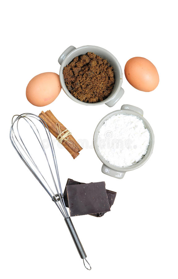 Sweet ingredients for cake, isolated. Ingredients for cake - flour, brown sugar, eggs, chocolate, cinnamon, isolated on white stock photos