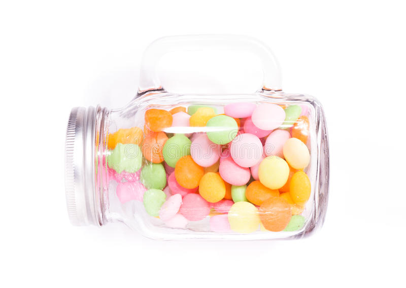 Sweet jar. Candy in a glass jar on white background stock images