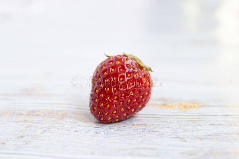 Sweet, juicy, ripe strawberries. Red, large strawberries Food with vitamins. Vegetarian food. On a light wooden background royalty free stock photo