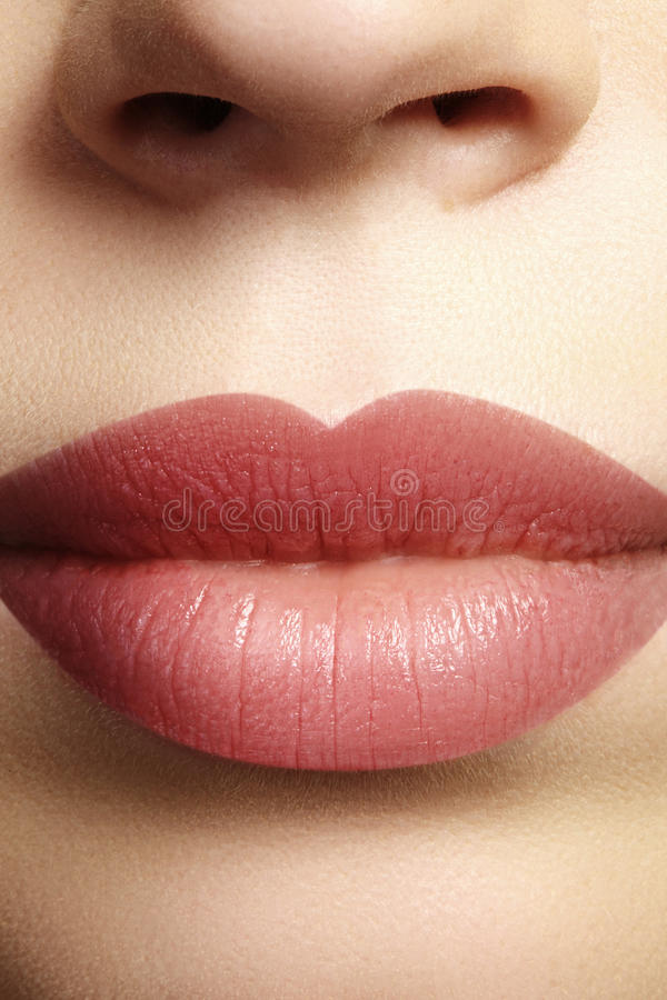 Sweet kiss. Perfect natural lip makeup. Close up macro photo with beautiful female mouth. Plump full lips. Close-up face detail. Perfect clean skin, light royalty free stock photo