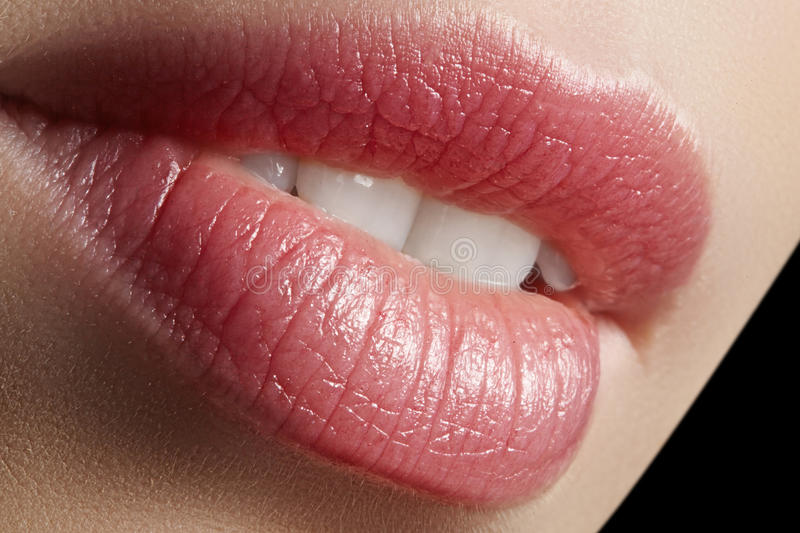 Sweet kiss. Perfect natural lip makeup. Close up macro photo with beautiful female mouth. Plump full lips. Close-up face detail. Perfect clean skin, light royalty free stock photography