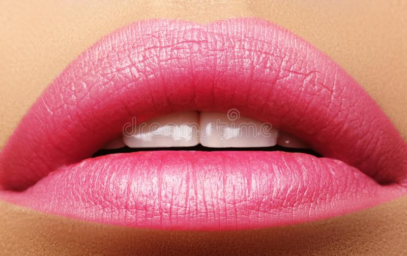 Sweet kiss. Perfect natural pink lip makeup. Close up macro photo with beautiful female mouth. Plump full lips royalty free stock photography