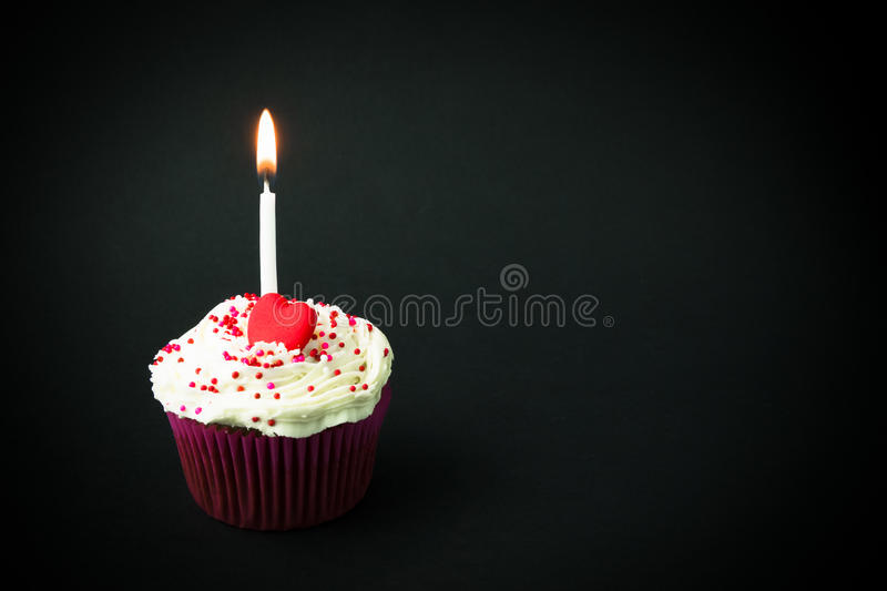 Sweet little birthday cake. With candles, grey background royalty free stock images