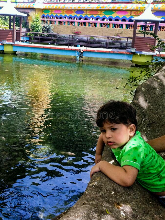Sweet Little boy giving pose for the photography near Batu Caves temple in Malaysia, Cute baby boy enjoying on the playground royalty free stock image