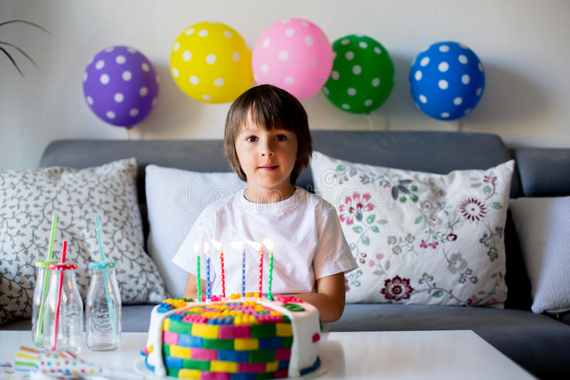 Sweet little child, boy, celebrating his sixth birthday, cake, b stock images