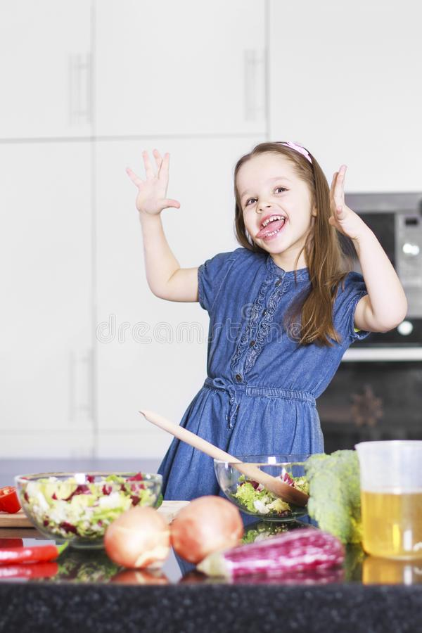 Little cute girl indulges in kitchen, Family concept royalty free stock image