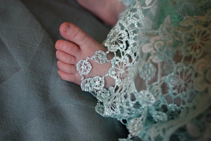 Baby Toes Peeking Through Embroidery stock photography