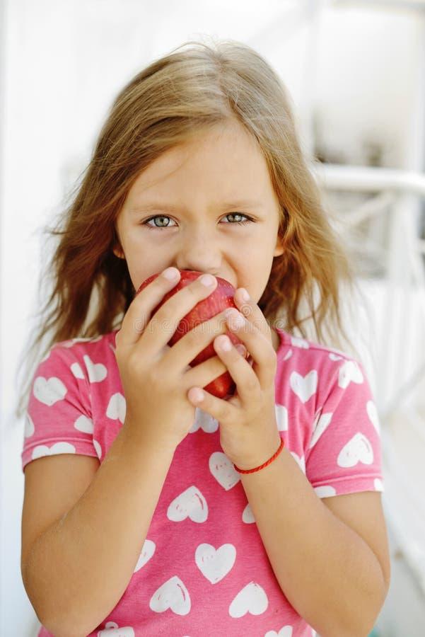 Girl eating apple stock images
