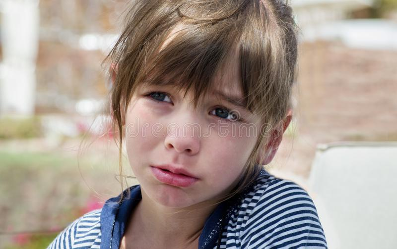 A sweet little girl pouted and cried, offended, a childish whim.  stock images