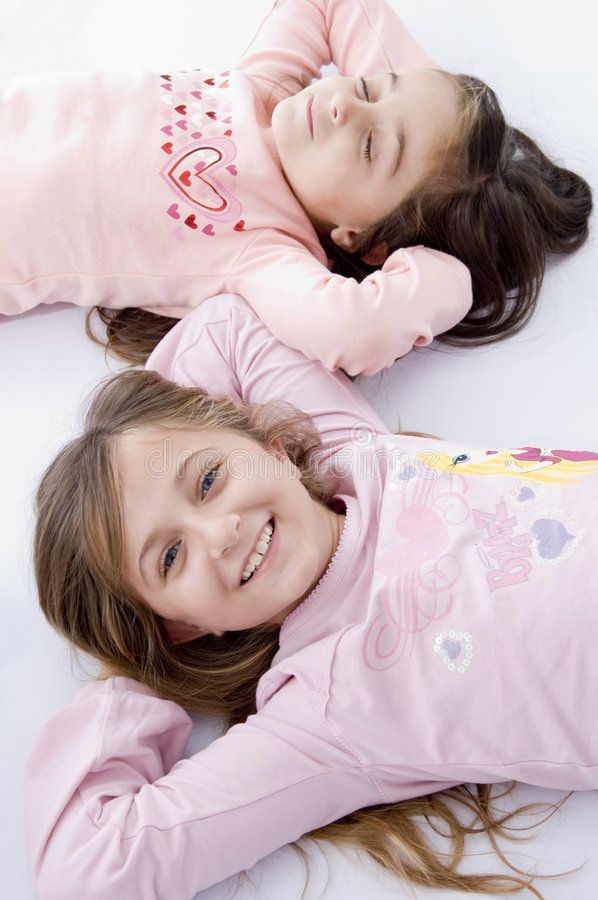 Download Sweet Little Laying Sisters Stock Image - Image: 7026035