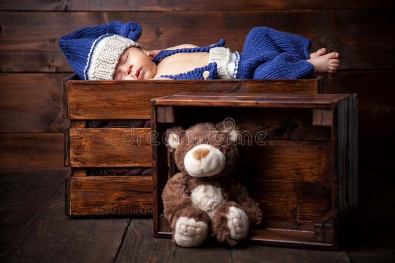 Sweet little newborn inside a wooden crate royalty free stock photography