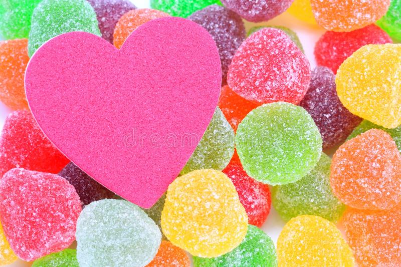 Sweet love. Colourful soft jelly candy with heart shape object on white background. Concept for sweet love stock photography