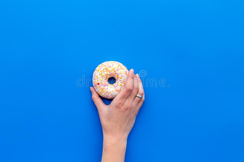 Sweet lunch with glazed donut on blue background flat lay mockup stock photos