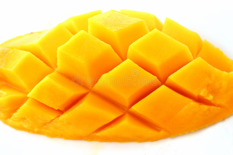 Sweet mango. Half slice of a yellow ripe mango artfully carved into a cube design. Rich in vitamins A, C & D. Latin word is Mangifera indica and is believed to