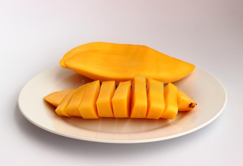 Sweet mango on a white dish stock image