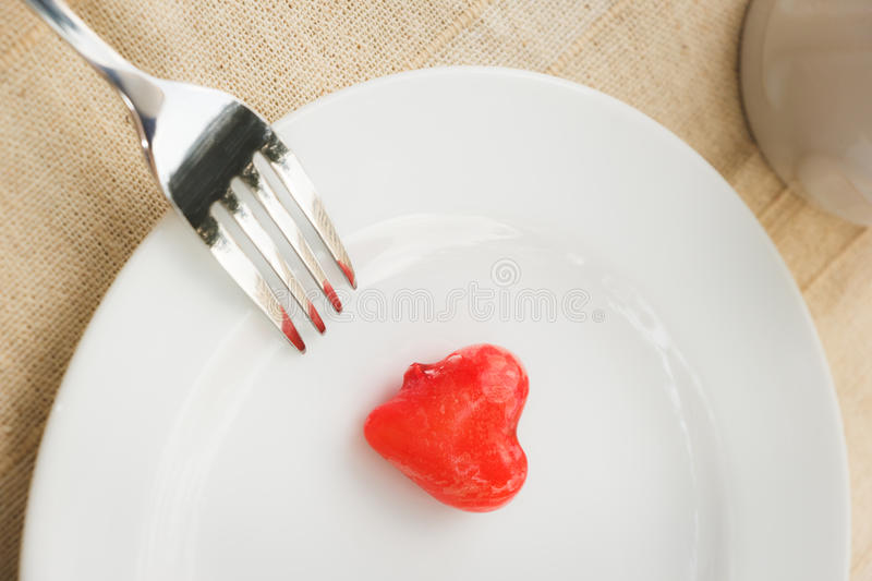 Sweet meal. Light meal with close up of sweet food or deletable imitation fruits (heart shape stock images