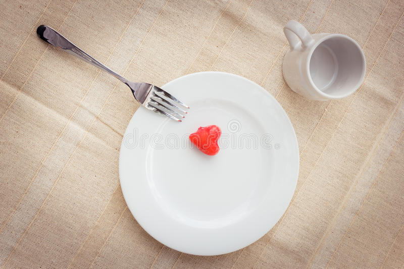 Sweet meal. Light meal with sweet food or deletable imitation fruits (heart shape royalty free stock photo