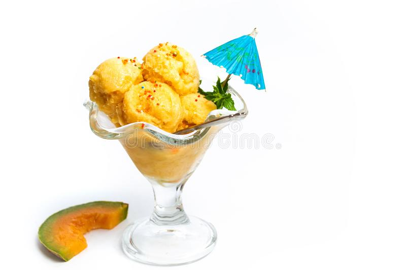Sweet melon ice cream dessert on white. Isolated fruit cup ice-cream food orange cantaloupe icecream sorbet tropical scoop fresh ripe sundae gelato frozen royalty free stock photography