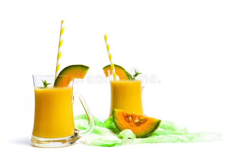 Sweet melon smoothie isolated on white. Sweet melon smoothie juice isolated on white glass drink beverage slice cut cantaloupe cantalupe healthy food nobody royalty free stock images
