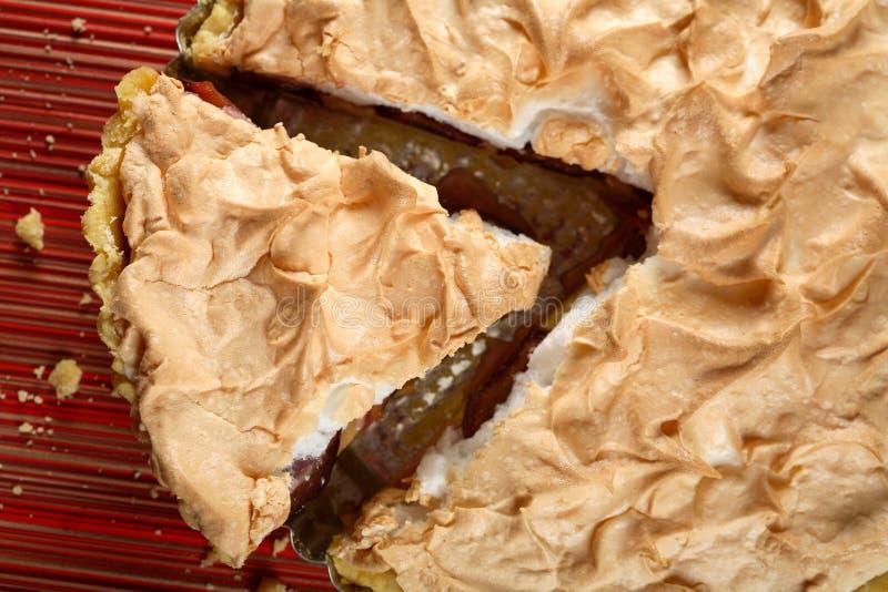 Sweet meringue with plum stock image
