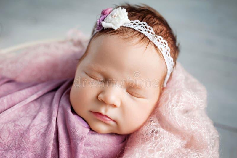 Sweet newborn baby sleeping. Newborn girl 3 weeks old lying in stock photo