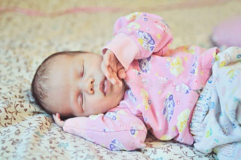 Sweet newborn girl stock photography