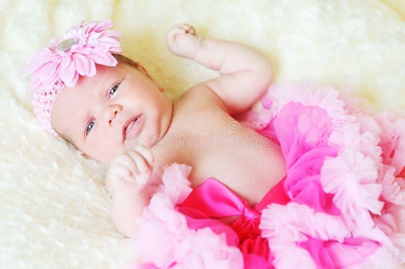 Sweet newborn girl stock photos