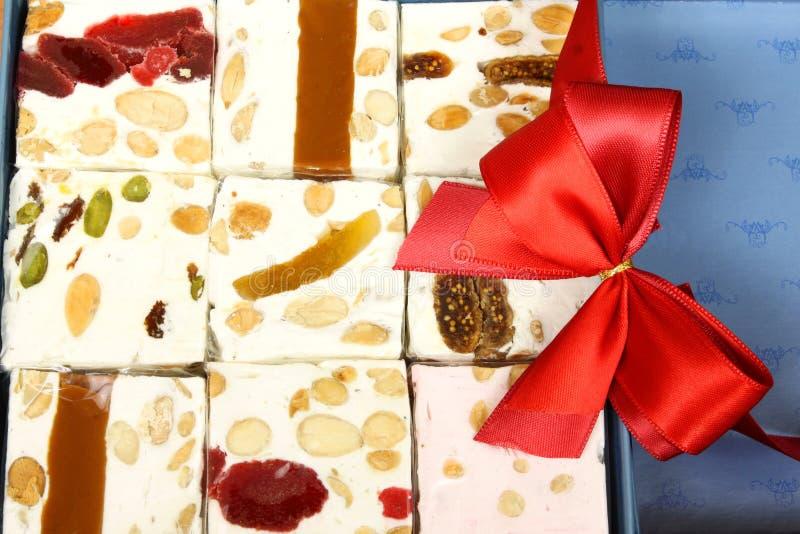 Sweet nougat bars in box royalty free stock photos