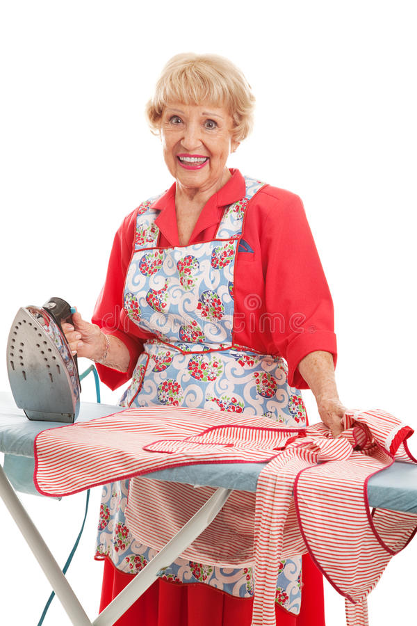 Sweet Old Lady Ironing stock photos