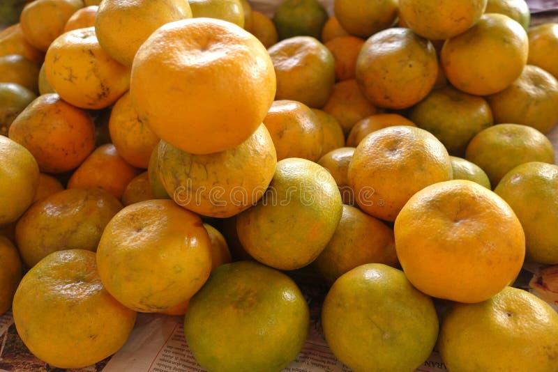 Sweet orange fruit pile. Indonesia sweet orange pile sell in traditional market, yogyakarta, Indonesia royalty free stock photography