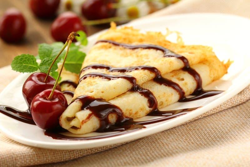 Sweet pancake with chocolate sauce royalty free stock photo