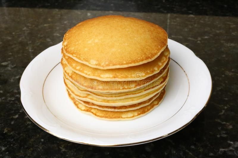 Sweet pancakes for breakfasts, snacks and as a dessert. Sweet pancakes for breakfasts, snacks and as dessert typical of English cuisine. Photo of stacked royalty free stock photo