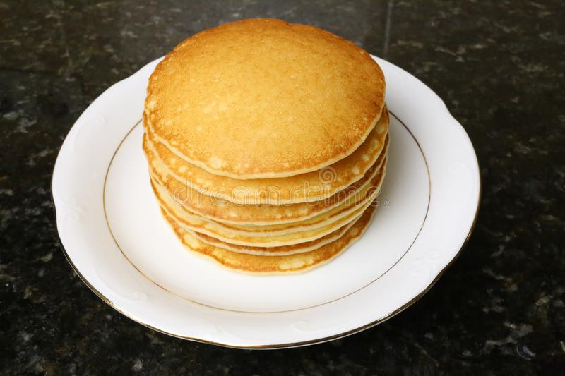 Sweet pancakes for breakfasts, snacks and as a dessert. Sweet pancakes for breakfasts, snacks and as dessert typical of English cuisine. Photo of stacked royalty free stock image