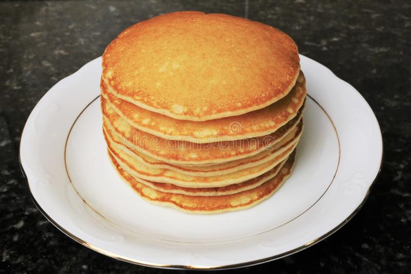 Sweet pancakes for breakfasts, snacks and as a dessert. Sweet pancakes for breakfasts, snacks and as dessert typical of English cuisine. Photo of stacked stock image
