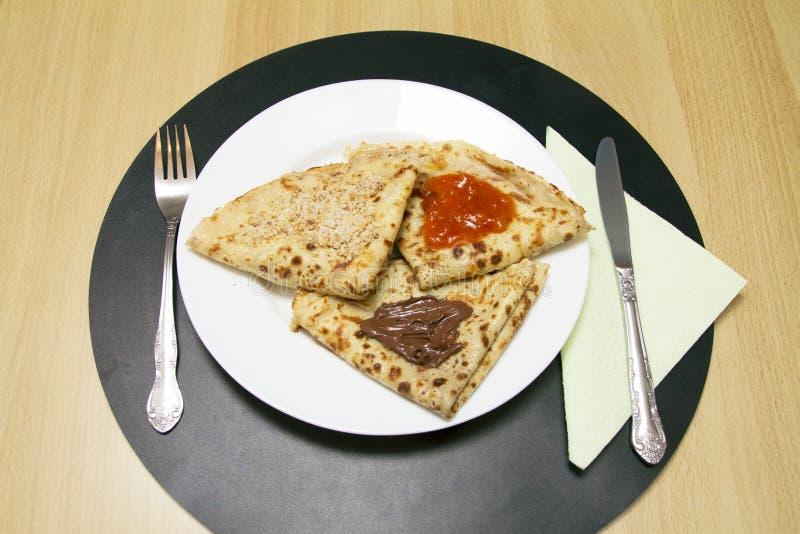 Sweet pancakes-chocolate jam walnuts on white plate. stock photos