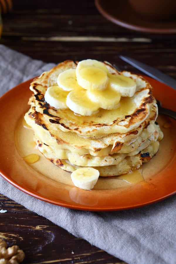Sweet pancakes with honey and bananas stock image