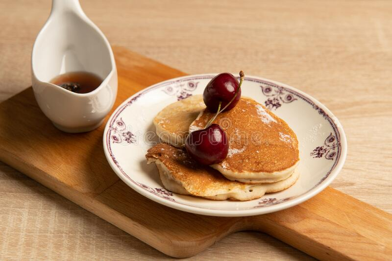Sweet pancakes with jam and cherry royalty free stock image