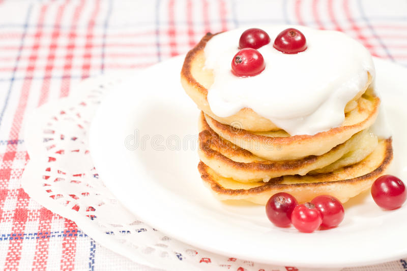 Sweet pancakes with sour cream royalty free stock photography