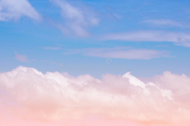 Sweet pastel colored cloud and sky with sun light, soft cloudy with gradient pastel color background royalty free stock image