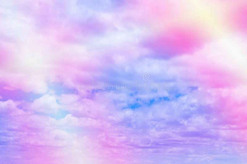 Sweet pastel colored cloud and sky with sun light, soft cloudy w. Ith gradient pastel color background. summer concept stock image