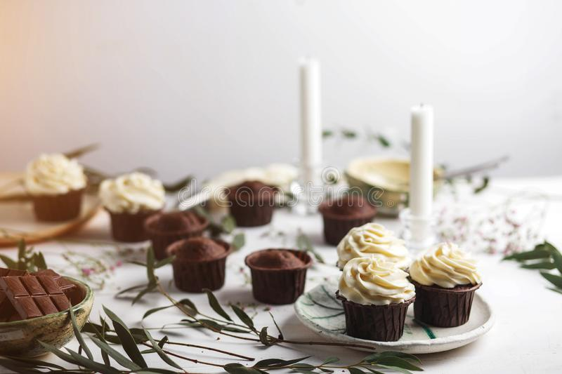 Sweet pastries, muffins and cupcakes on the table stock photo
