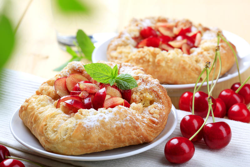 Sweet pastry. Crisp Danish pastries topped with fresh cherries stock photography