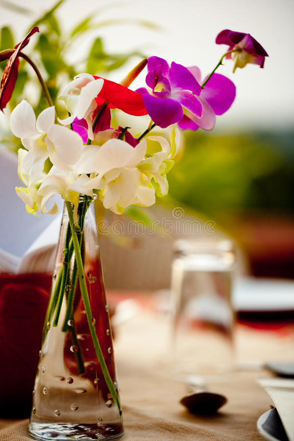 Sweet pea in vase at Banquet Table Setting With flower at Garden Patio restaurant. Fine Banquet Table Setting With flower Table at Garden Patio restaurant Kerala royalty free stock photo